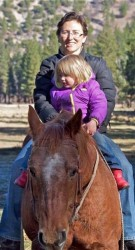 Riding my old mare Sandy with my daughter on a chilly November day.