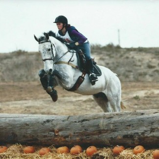 Jumping on gray horse